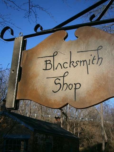 A sign for a blacksmith shop