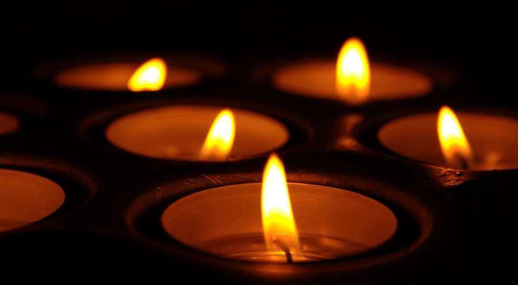 A couple of flickering candles Image Source