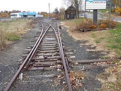 A Fork in the rr tracks near a small town Image Source