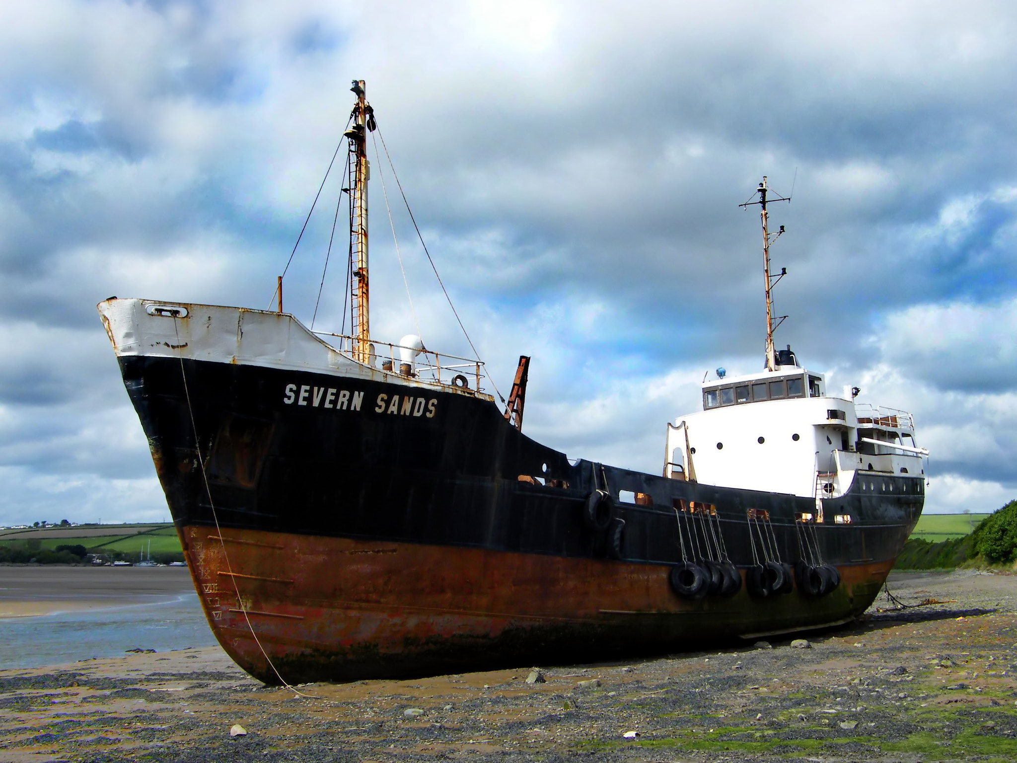 The rusty derelict dredger ship Severn Sands is run aground in Fremington Quay